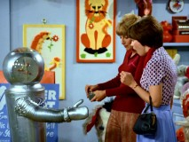 Roger the Robot offers Shirley a friendly handshake before he later attempts to kill Laverne.