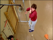 "Shirley is not very comfortable climbing up a gym rope in ""The Obstacle Course."""