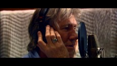 "Former Pink Floyd member Roger Waters rocks out in his music video for ""Hello (I Love You)"", an original song not to be confused with The Doors' hit."