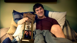 Defending league champion Pete Eckhart (Mark Duplass) proudly cuddles up with The Shiva, the winner's trophy bearing a photo of the gang's high school valedictorian.