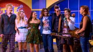 In this Extended Edition DVD's exclusive ending, the newly-expanded Lemonade Mouth appears on talk show The Music Scene with host Moxie Morris (Lauren Poole, far right).