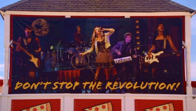 Lemonade Mouth knows they've made it when they see this giant photo of them hanging atop Dante's Pizzeria.