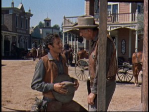 Elfego and deputy sheriff Ed Morgan (Robert F. Simon) update each other in the streets of their Western town.