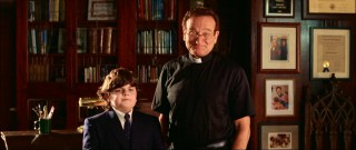Reverend Frank (Robin Williams) and his short sidekick Choir Boy (Josh Flitter) meet with the prospective couple.