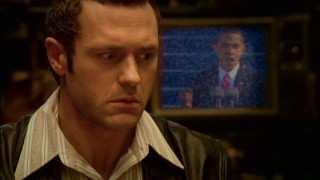 Sam (Jason O'Mara) perks up as the TV behind him shows a bit of Nobel Peace Prize winner Barack Obama's presidential inauguration, one of many 2009 things Sam is missing.