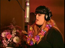 "Wynonna Judd gets Hawaiian to record her pleasant film-closing cover of ""Burning Love."""