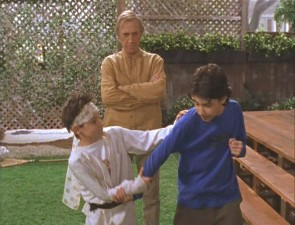 David Carradine watches as Matt puts the karate moves on Gordo.