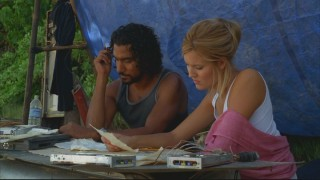 Sayid and Shannon work together to try to decipher a found map of the island.