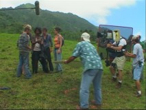 Setting up a scene on the rolling green hills of Oahu.