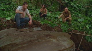 Jack examines the hatch that Locke and Boone have worked for weeks to dig up secretly.