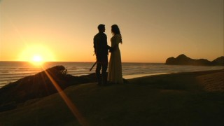 Richard (Craig Horner) and Kahlan (Bridget Regan) have an intimate sunset to themselves on a beach.