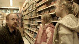 The best and longest deleted scene finds Louie struggling to get an inconsiderate cell phone chatting grocery store patron to corroborate for his young daughters the importance of apologizing.