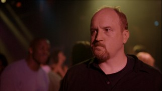 Louie (Louis C.K.) struggles to fit in at a loud nightclub in the Season 1 finale.