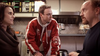 On a donut shop date with Sandra (Amy Landecker, who two episodes later plays Louie's childhood mother), Louie receives a threat of violence from high school jock Sean (Michael Drayer).