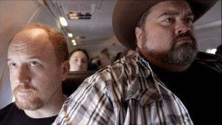 Flying down to Alabama, Louie finds himself on a small plane seated next to a very large passenger (Gregory Gunter).