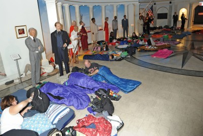 As wax renderings of world leaders stand watching, children and adults get tucked into sleeping bags for a night at the museum.