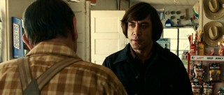 While on Moss' trail, Anton Chigurh (Javier Bardem) meets local folk like the gasoline clerk who quickly becomes his friend-o.