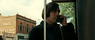 Anton Chigurh (Javier Bardem) phones a friend-o.