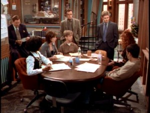 "The eight lead cast members of ""NewsRadio"" gather around the table for one of their regular conferences."