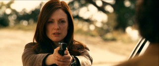 "As FBI Agent Callie Ferris, Julianne Moore strikes a pose that her ""The Fugitive"" co-star Tommy Lee Jones did more convincingly and with more depth."