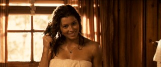 "Wet out of the shower, Liz (Jessica Biel) smiles at Cris Johnson, who responds with faux-intellectual citation of how ""Italian painter Carlotti"" defines ""beauty."""