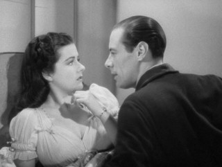 Anna (Margaret Lockwood) and Gus (Rex Harrison) play up the fake romance their plan hedges on.