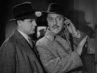 Deadpan comic relief destined for their own radio series and film, Charters (Basil Radford, right) and Caldicott (Naunton Wayne) luck out in overhearing a critical enemy phone call. Good show, old boys.