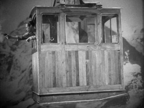 Okay, so maybe it doesn't look like Gus/Dicky/Ulrich (Rex Harrison) is really riding a cable car across the Swiss Alps, but the film's gunfight finale still excites.