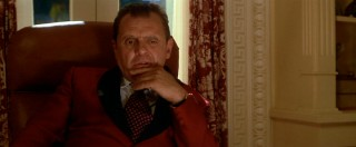 Richard Milhous Nixon (Anthony Hopkins) sits slouched in his chair while looking depressed.