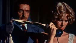 "A Ray Milland-Grace Kelly scene from ""Dial M for Murder"" illustrates ""The Master's Touch: Hitchock's Signature Style."""