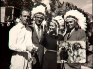 "Cary Grant and Eva Marie Saint don headdresses and pose with South Dakota locals in a still from ""Destination Hitchcock."""