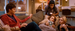 Adam's (Ashton Kutcher) period-themed mix CD may be a relationship move, but it impresses Emma's friends (Mindy Kaling and Greta Gerwig), with whom she shares a place and a menstrual cycle.