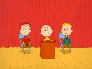 You can get with this or you can with that... Charlie Brown introduces the candidates for Birchwood School's next student body president: Linus van Pelt and Russell Anderson.