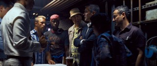 Danny again calls the shots in this latest gathering of the Ocean's gang. Among those seen here are, left to right, Scott Caan, Don Cheadle, Carl Reiner, and Eddie Jemison, each playing a skilled part in the plan.