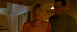 Pretending to be the personal assistant of a high-rolling Asian, Matt Damon looks Val Kilmer-esque with a prosthetic nose as he woos Bank's cougar assistant Abigail Sponder (Ellen Barkin) in the name of diversion.