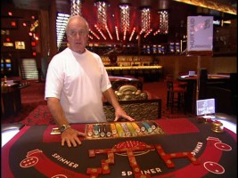 "Producer and occasional actor Jerry Weintraub shows off the Bank Casino set created for ""Ocean's Thirteen."""