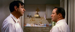 Oscar (Walter Matthau) and Felix (Jack Lemmon) stare each other down, as one source of contention (a strewn plate of spaghetti -- er, linguini) stands between them on the wall.