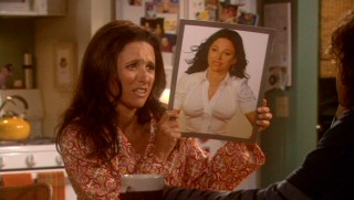 Self-centered divorcée Christine Campbell (Julia Louis-Dreyfus) longingly holds a photo depicting what she'd look like with cosmetically-enhanced lips and breasts.