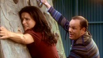 Fellow private school parent Mike Gay (Tom Papa) tries to talk a depressed Christine down from a rock climbing wall.