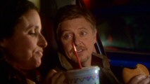 Looking for pot, Christine settles for an in-car fast food meal with a man whose name she can't remember (Dave Foley).