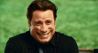 Facial paralysis causes this creepy wide smile to freeze on Charlie's (John Travolta) face at an inopportune time.