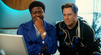 In his last film released, late comedian Bernie Mac plays Jimmy Lunchbox, an entertainer who lets Charlie (John Travolta) try out his human puppeteering technology.