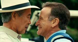 With his depth perception gone as a side effect of mistaken medication, Dan (Robin Williams) gets very close to greet Mr. Nishamura (Saburo Shimono). Oh for silly!