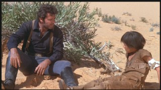 After shooting the boy, Clint gets formally introduced in the desert