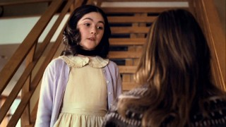 Esther (Isabelle Fuhrman) defends her decision to wear a Victorian dress on her first day at a new school.