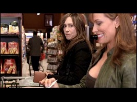 Kate (Vera Farmiga) sees neighbor Joyce (Lorry Ayers) at the grocery store checkout line, an encounter Esther uses for manipulation.