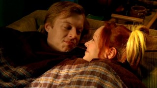 Physical Phil (Jay Paulson) and Pizza Girl (Lindy Booth) share a cozy moment together thanks to the autumn season that never seems to ebb.