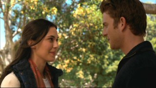 Aubrey (Odette Yustman) and Nick (Bryan Greenberg) share a slightly awkward reunion amidst college campus foliage.