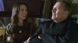 Aubrey (Odette Yustman) spends some quality time on a ferris wheel with her father (Armand Assante).
