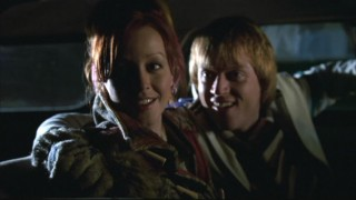 Phil (Jay Paulson) and Pizza Girl (Lindy Booth) admire Christmas decorations left up by their neighbors.